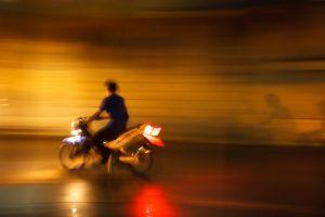 motorcycle driver not wearing helmet